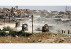 伊拉克民防人员在摩苏尔战区废墟挖掘出千余具尸体