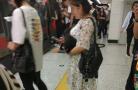 沈阳一女子早高峰抱狗坐地铁 她是怎么过的安检