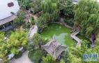 郑州闹事区里的小庭院:亭台楼榭 石刻木雕