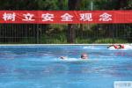 炎夏将至!北京青年湖露天泳场开展溺水救生演练